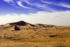 From the top of dunes (TARIQ-M) Tags: shadow sky cloud texture sahara landscape sand waves pattern desert patterns dunes wave riyadh saudiarabia   canoneos5d         canonef70200mmf4lusm         dahna canoneos5dmarkii        tariqm  aldahna  tariqalmutlaq ripplesripple