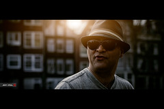 Some guy in Amsterdam (Jeff Krol) Tags: street windows portrait sunlight cinema man hat sunglasses canon person eos glasses bokeh candid snapshot streetphotography portraiture backlit cinematic f28 2012 70200mm 70200l img7490 ef70200mmf28lusm 60d canon60d jeffkrol