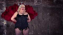 Sparkles and feathers (elizunseelie) Tags: show red color colour sexy brick art smile wall glitter scarlet 50mm scotland fan costume big theatre pentax glasgow vibrant live stage performance feathers dramatic sensual historic laugh blonde grin corset crown colourful variety cabaret jewels sequins burlesque musichall plump act k5 britannia panopticon variete