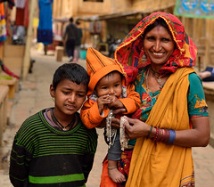 Different expressions (sanat_das) Tags: street boy woman baby 50mm jaisalmer rajasthan trinkets d800
