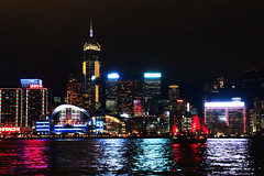 The Victoria Harbour at night (Carrie YL) Tags: sea reflection night sailboat colorful highrises victoriaharbour exhibitioncenter