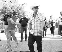Gaucho (GJosephT) Tags: street people monochrome walking 28mm omaha cowboyhat fixedlens ricohgrii cincodemayocelebration