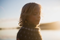 Golden hour (Dalla*) Tags: light boy sunset summer portrait people lake wool backlight outside outdoors golden evening iceland sweater kid twilight glow child glowing hafnarfjrur hvaleyrarvatn icelndic dallais