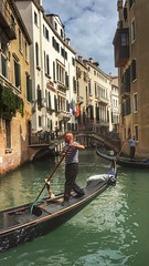 Gondola ride. (mikeatkinson751) Tags: door bridge venice houses sky italy plants man colour men tourism window water beauty hat clouds buildings design canal transport tourist flags carving romance gondola arcitecture orr windowbox mobilephonephotos iphone iphone6