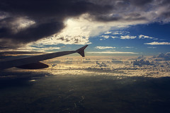 Flying from Amsterdam (Estl C.) Tags: voyage travel sunset clouds plane de soleil coucher vol nuages avion