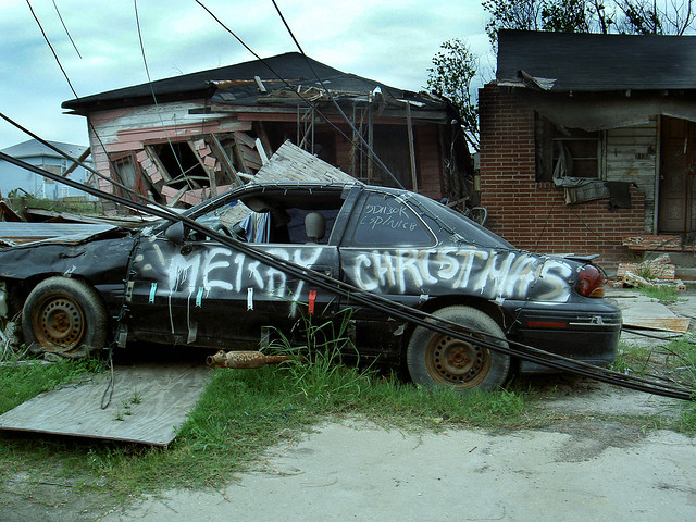 Damaged Houses and Car