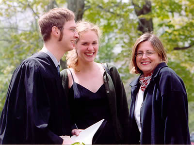 Graduate Andrew Sandlin and Junior Sonja Reitsma Talk with Faculty Member Kate Ratcliff