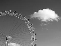 London Eye (Gianlucamonaco) Tags: birthday sky bw panorama cloud white black london eye canon nuvola cielo panoramica bianco londra nero occhio ruota g11