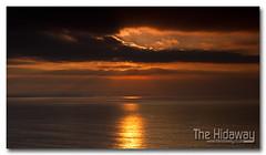 Sunpath to St Ives - Explore #409  12/02/12 (Simon Bone Photography) Tags: sea sky cloud sun reflection silhouette cornwall stives stagnes whealcoates sunpath cornishcoast cornishsunsets wwwthehidawaycouk canoneos7d canonef24105mmlf4