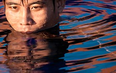 The swimmer (#2) (edwindejongh) Tags: portrait reflection guy water pool face swimming asian nager cambodian zwembad portret watercolours youngman cambodja jongen zwemmen aziatisch aziaat