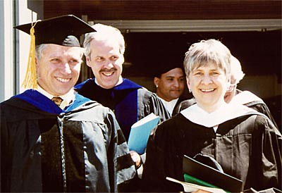 Dean of Faculty John Hayes, President Paul LeBlanc, and Outgoing Director of Advising Hilly van Loon '62 Emerge.