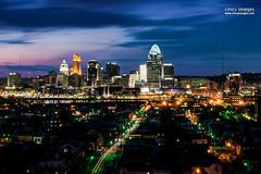 Cincinnati Skyline (cincyimages) Tags: city sunset ohio urban colors skyline night midwest colorful cityscape skyscrapers vibrant cincinnati newport streaks cincinatti ohioriver cinci highrises density cincinnatiskyline lightstreams cinti cincy queencity top20flickrskylines