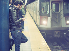 Standing, with style. (Linh H. Nguyen) Tags: street newyork train subway bokeh snapshot 5014 rokkor nex7 manandhisphone