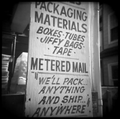 Pack Anything (Voxphoto) Tags: blackandwhite bw sign advertising holga annarbor business tape tmax400 sq 120s