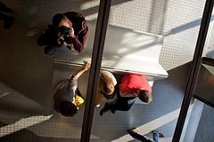 Family Portrait (mrjaja) Tags: barcelona camera family portrait reflection metal shop bench mirror spain candid seat entrance catalonia pillars vincon vinon canoneos500d mrjaja