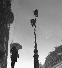 Alter ego (vieweronline) Tags: street blackandwhite bw paris france monochrome rain contrast noiretblanc streetphotography pluie nb alterego portfolio candids rue gens candidshots photosderue ahmedmokhtar canong12 vieweronline