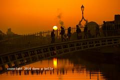 Ha'penny Sunset (Dave G Kelly) Tags: city bridge ireland sunset urban dublin sun water river golden evening dusk liffey hapennybridge peoplecrossing