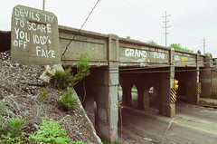 (pop archaeologist) Tags: city bridge film canon underpass graffiti kodak michigan devils fake overpass 100 scare flint eos5 railwaybridge 28105 gold200 grandfunkrailroad eosa2
