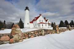 Point Iroquois Lighthouse - Whitefish Bay, Michigan (Michigan Nut) Tags: winter sky lighthouse snow nature stone clouds fence geotagged outdoors photography michigan whitefishbay lakesuperior johnmccormick pointiroquoislighthouse michigannutphotography