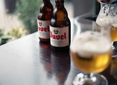 Duvel (Jorkew) Tags: 120 mamiya film water beer glass colors field fog bar analog table nc cafe 645 dof belgium belgie natural beers drink c foggy drinks alcohol 400 devil medium format portra400nc belgian bier antwerp portra depth duvel f28 glas antwerpen mamiya645 80mm belgisch portra400 kodakportra400nc kodakportra400 speciaal kodakportra sekor anverse duvelbeer mamiyasekorc80mmf28 lanvers duvelbier belgischspeciaalbier