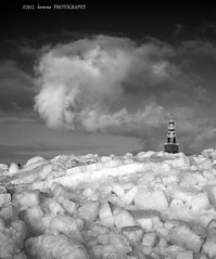 Ice Mountains (Jurjen Harmsma Photography) Tags: winter sky mountains tower ice church nature rock clouds landscapes town rocks frost skies seasons wind air cities friesland forces ijsselmeer hindeloopen 2012 frisian airscapes icerock