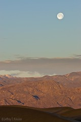 Sun and Moon Rise over Death Valley (Jeff Kreulen) Tags: california morning blue red sky cloud moon white mountain snow southwest west vertical america sunrise gold golden early sand desert dune moonrise lunar reddish stovepipewells deathvalleynationalpark mesquiteflat