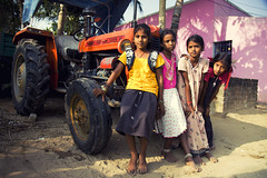 Colors of India!!! (VinothChandar) Tags: street pink girls red people orange india tractor color colour colors beautiful beauty kids rural canon children photography photo colorful colours village photos vibrant vivid pic colourful chennai beauties tamilnadu yello thirumazhisai pcsture