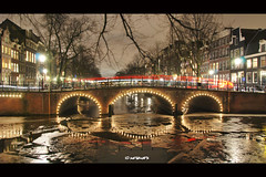 Mirror Magic Amsterdam (JdJ Photography (Aardewerk)) Tags: city bridge trees light house holland ice wet water netherlands amsterdam night dark evening licht living canal bomen gate europa europe downtown traffic streetlights branches centre nederland nat headlight lamps lit innercity brug huis avond twigs mokum centrum brakelight province stad poort takken noordholland donker gracht lampen brouwersgracht ijs benelux wonen verkeer randstad canalhouses remlicht binnenstad grachtenpanden provincie northholland verlicht koplamp lantaarnpalen amsterdamcentrum straatverlichting amsterdamcitycentre upc0212blogns icesterdam upc0212 upc0212blog
