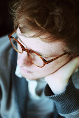 one and only. (Casey David) Tags: blue boy red portrait man love beautiful fossil grey glasses sweater waiting sitting thoughtful redhead round wait freckles simple fossilglasses