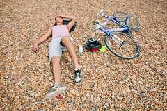 Sleepy cyclist #5 (lomokev) Tags: sleeping portrait england man male beach bike sport canon private person eos brighton cyclist unitedkingdom stones sleep human 5d exhausted londontobrighton sleeeping canoneos5d shotonhscourse londontobrighton2012 file:name=120617eos5d9070