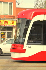 Streetcars in Chinatown (wyliepoon) Tags: chinatown trolley ttc tram transit lightrail streetcar lrt downtowntoronto bombardier spadinaavenue flexity