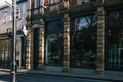 Street (JacksonSwaby) Tags: road street light sky reflection building tree brick window shop stone bar cafe bricks structure