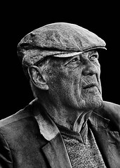 Portrait (D80_441695) (Itzick) Tags: man face hat blackbackground copenhagen denmark candid d800 facialexpression bwportrait itzick