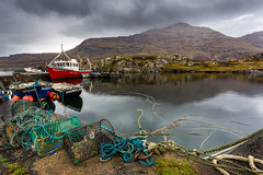 Connemara landscape (Sigita JP) Tags: red colour landscape boat view darkclouds calmbethestorm