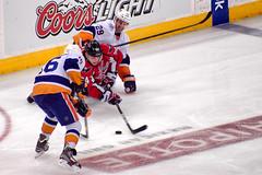 Carlson Plays Puck From Knees (clydeorama) Tags: usa newyork ice hockey nhl washingtondc dc washington carlson caps icehockey center puck verizon capitals islanders nationalhockeyleague verizoncenter reasoner pandolfo