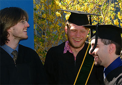 Graduates Gahlord Dewald, Todd Andrews and Mike Booxbaum Share a Laugh.