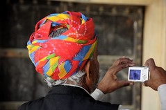 Taking a colourful picture! (Saumil U. Shah) Tags: camera travel blue red people india color colour green heritage history tourism colors beautiful yellow architecture photography amber photo colorful colours photographer dress bright fort traditional picture palace tourist historic click colourful turban fortress jaipur rajasthan amer shah headgear rajasthani jaigarh  saumil aravalli  incredibleindia    saumilshah