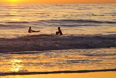 Holding the line (Damian Gadal) Tags: arroyoburrobeach santabarbara california surfers sunset silhouette nikon d80 geotagged nikond80 december 2011 free creativecommons