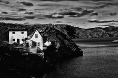 (Explore) Brig House, Brigus, Newfoundland (Kenneth (over 1,000,000 views)) Tags: ocean sea sky blackandwhite white mountain snow canada black tourism monochrome clouds newfoundland dark flickr ominous foreboding whitehouse cliffs hills prison shackles shipping atlanticocean arrest brig shackled brighouse thebrig penal penalcolony incarcerate mygearandme dblringexcellence