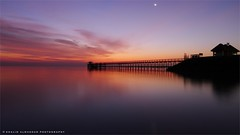 Charming morning (khalid almasoud) Tags: leica morning bridge sea beach sunrise flickr all quiet photographer slow purple 5  magenta rights estrellas shutter kuwait charming khalid reserved dlux december22 wintry  2011  greatphotographers   photographyrocks almasoud flickraward  thebestofday gnneniyisi
