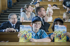 Kids hold up comic books at the Annual Summit in Leipzig