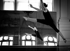 defying gravity (Jen MacNeill) Tags: blackandwhite bw girl mirror jump dancer gymnastics leap defyinggravity flickrfriday jennifermacneilltraylor jmacneilltraylor