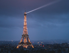 Light the way (-christine!) Tags: city blue light sunset sky paris tower night dusk eiffel beacon