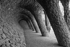 The Wave (JJ Photog) Tags: barcelona park bw white black statue rock stone architecture ceramic spain outdoor path wave walkway gaudi archway guell antoni