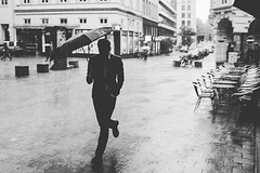 My great capture during a heavy rain shower. . . . . #suit #officelook #menstyle #gentleman #cityscape #bigcity #streetphotography #streetlife_award #blackandwhite #streetlife #reflection #hunting #outdoors #raining #wet #drops #walking #clouds #lighting (renehamburg) Tags: fujix100t umbrella suit colonnaden hamburg run rainshower style rain instagramapp square squareformat iphoneography moon