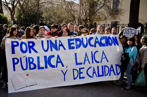 Students with a banner calling for public educ...