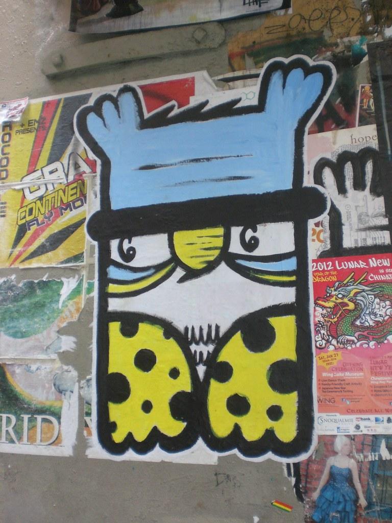 Postalley 007 evil robot 6 tags seattle streetart art graffiti stickers owl pikeplacemarket