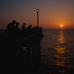 sunset fishing. steeplechase pier, coney island (Barry Yanowitz) Tags: ocean nyc newyorkcity sunset ny newyork 6x6 film beach brooklyn mediumformat coneyisland pier fishing sand sunsets 120film scanned boardwalk gothamist filmcamera nycity fujivelvia50 718 coneyislandpier steeplechasepier rolleicordv