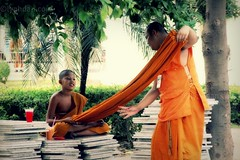 Dare to Reach Out (lynhdan) Tags: life orange thailand asia southeastasia child monk help thai pattaya socialdocumentary novice chonburi earthasia totallythailand lynhdan watchai