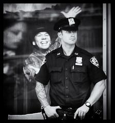 No laughing matter (Frank Fullard) Tags: street nyc portrait bw usa ny tattoo ink mono us manhattan candid timessquare cop policeman inked tats fullard frankfullard